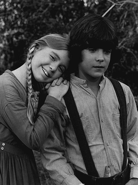"Publicity photo of American child actors, Matthew Laborteaux and Katy Kurtzman promoting their roles as young Charles and Caroline Ingalls on the episode of the NBC television series ""Little House on the Prairie."" 