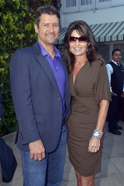 Todd Palin is joined by his wife, former Alaska Governor and Vice Presidential candidate Sarah Palin, at NBC's TCA Party, July 24, 2012 | Photo: Getty Images