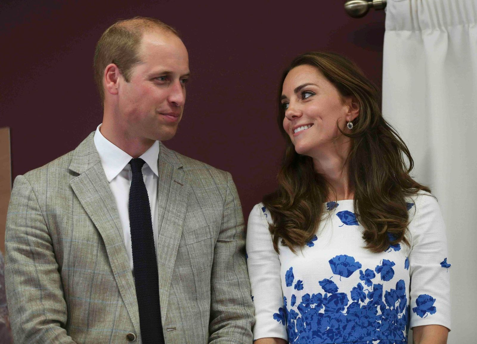Kate Middleton and Prince Willaim listen to a speech during their visit to Keech Hospice Care on August 24, 2016. | Getty Images