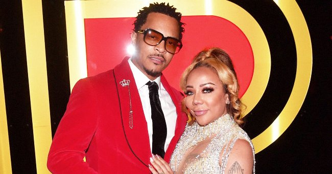Tiny Harris Stuns in a Beaded Fringe Dress with Chest Cut Out in New Photos with Husband T.I.