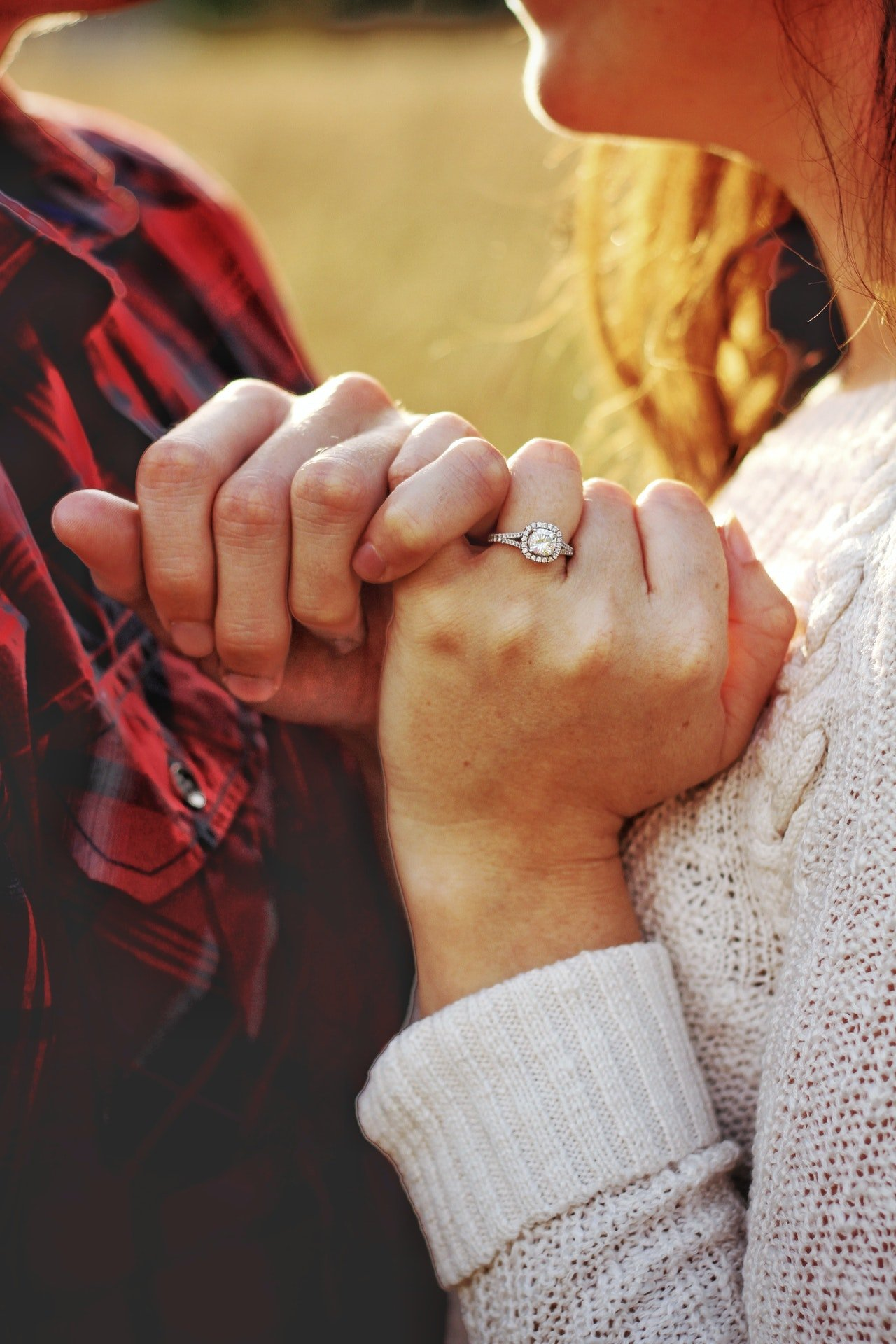 Happy couple showing off their ring   Photo: Pexels