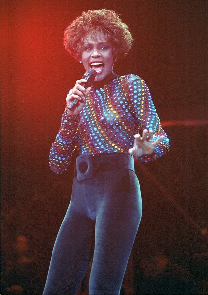 Whitney Houston performing on stage at Wembley Arena, London, 03 September 1991 | Photo: Getty Images