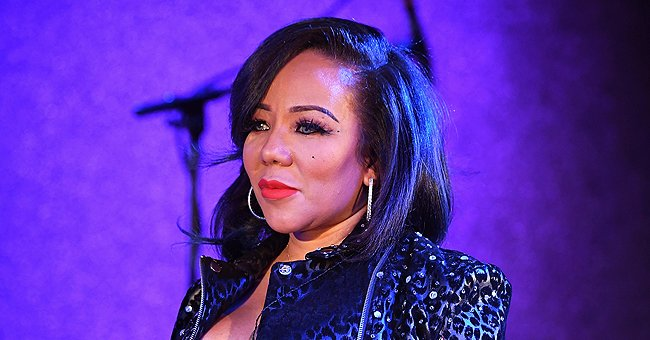 See Tiny Harris' Granddaughter Hunter's Precious Smile in a Pink Outfit & Flower Bow (Photos)
